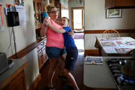 "Malden, MA- July 08, 2017: Roberta Biscan and her son Connor danced before saying goodbye at her parents' home in Malden last June. Karen and Jeff Francis agreed to babysit for the night so she could attend a New Kids on the Block concert at Fenway Park with her two sisters. ""Thank God I have the parents I do,'' Biscan said. ""No matter how challenging things can be with Connor, they're consistently there to help."" She was excited about doing something fun. ""It helps me not to lose it completely,'' she said. ""I only get these opportunities once in a while so I have to take advantage of them."" (Craig F. Walker/Globe Staff) section: metro reporter: kowalczyk"