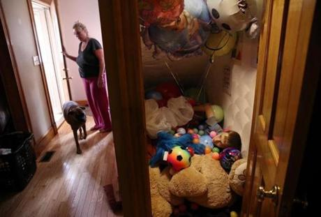 "Wilmington, MA- September 16, 2017: Connor Biscan, 13, rested in his ""sensory closet,'' while his mother, Roberta Biscan, let in the dog at home in Wilmington last September. Roberta Biscan explained that Connor suffers from Sensory Processing Disorder, meaning ""he doesn't know where his body is in space."" The closet under the stairs is filled with comforting objects: pillows, blankets, stuffed animals, toys, and balloons. He buries himself amongst his favorite things. Roberta said their weight signals his nervous system to calm down. ""He can stay in there for hours,'' she said. (Craig F. Walker/Globe Staff) section: metro reporter: kowalczyk"