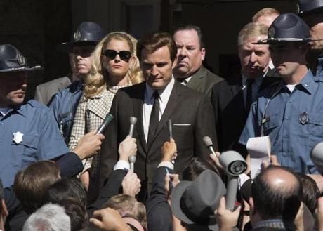 "This image released by Entertainment Studios shows Jason Clarke as Ted Kennedy, center, and Andria Blackman stars as Joan Kennedy in a scene from ""Chappaquiddick."" (Claire Folger/Entertainment Studios via AP)"