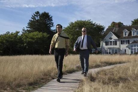 "This image released by Entertainment Studios shows Ed Helms stars as Joe Gargan, left, and Jim Gaffigan as Paul Markham in a scene from ""Chappaquiddick."" (Claire Folger/Entertainment Studios via AP)"