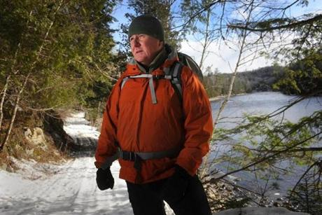 20180405 West Forks, Maine Photo by Fred J. Field Russell Walters of Carrabasset Valley, Maine paused by the shore of the Kennebec River in West Forks, Maine. He was walking to show visitors the area where a plan brings new high-voltage transmission lines across the pristine Kennebec River gorge near here. The lines would connect Hydro-Quebec to the New England grid. Walters is President of the rafting company Northern Outdoors. The Northern Pass project has collapsed, and now Massachusetts has turned to Maine as the way to make the project work. (Fred J. Field for The Boston Globe)