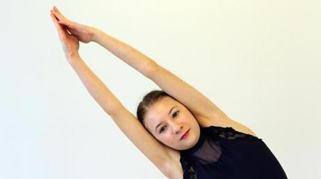 Avery LeMay, 12, warms up before practicing her yoga routine for an upcoming competition.