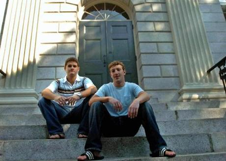 Facebook co-founder and Harvard students Mark Zuckerberg (right) and Dustin Moscovitz at Harvard Yard in 2004.