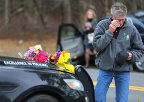 John Sinopoli cried and wiped a tear after he left off a bouquet of flowers on the cruiser belonging to slain officer Sean Gannon.