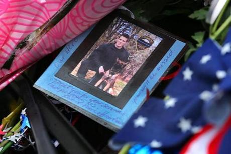 A photograph of slain Yarmouth K-9 officer Sean Gannon and his dog was displayed on the windshield of his cruiser.