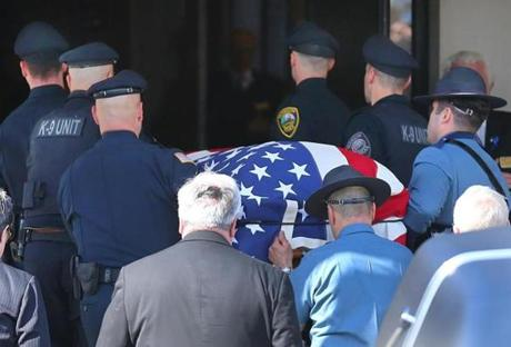 K-9 officers carried the casket into the church.