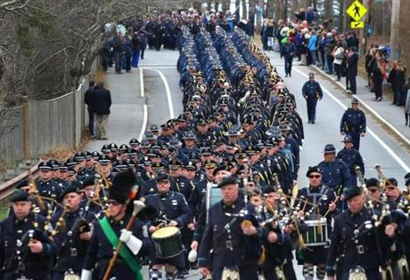Bagpipers led police from all over the country in a procession to St. Pius X Church on Tuesday.