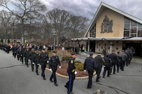 Police from all over the country held a procession and walk by and entered the church.