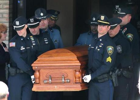 Yarmouth police officers helped carry the casket out after the service.
