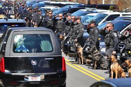 Hundreds of K-9 officers lined the road as the funeral procession made its way past the Yarmouth police station.