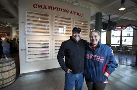 Red Sox curator Sarah Coffin (right) borrowed some of the bats for a display in the Royal Rooter's Club.