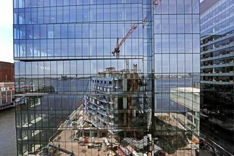 BOSTON, MA - 5/02/2018: Under construction a Seaport block: Pier 4 condos are reflected onto the Pier 4 office tower (David L Ryan/Globe Staff ) SECTION: BUSINESS TOPIC