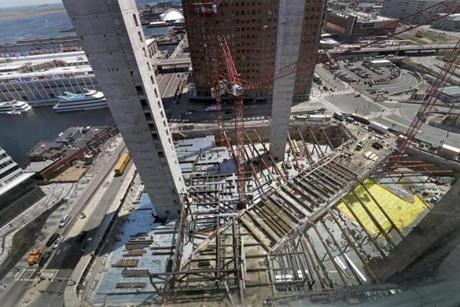 BOSTON, MA - 5/02/2018: Under construction a Seaport block: elevator shafts rise above the construction site of Echelon Seaport (David L Ryan/Globe Staff ) SECTION: BUSINESS TOPIC