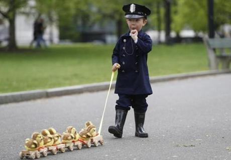 Boston, MA--5/13/2018-- Jonathan Krygowski, 4, of Westford blows the whistle before the start of the Duckling Day parade dressed as Michael from the children's story Make Way for Ducklings. (Jessica Rinaldi/Globe Staff) Topic: 14duckling Reporter: