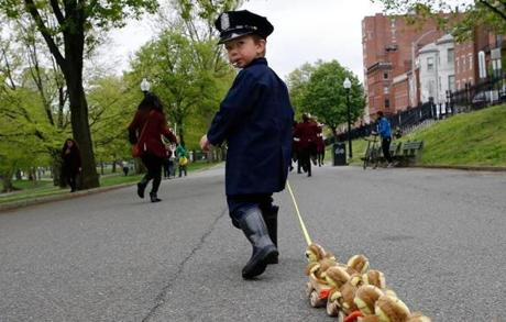 Boston, MA--5/13/2018-- Jonathan Krygowski, 4, of Westford blows the whistle as he leads the Duckling Day parade dressed as Michael from the children's story Make Way for Ducklings. (Jessica Rinaldi/Globe Staff) Topic: 14duckling Reporter: