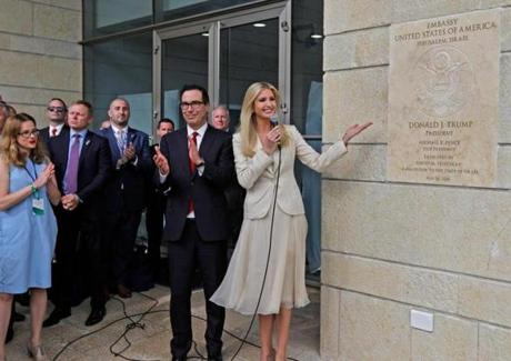 US Treasury Secretary Steve Mnuchin clapped as US President's daughter Ivanka Trump unveils an inauguration plaque at the embassy on Monday.