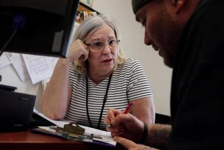 OTC Clinician Kathy Belanger (left) talked with a client about his needs after she secured a bed for him.
