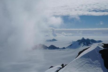 "Handout photo taken on January 8, 2011 and received on June 12, 2018 via the Nature website shows summer clouds swirling in around the Staccato Peaks of Alexander Island, Antarctic Peninsula. Antarctica has lost a staggering three trillion tonnes of ice since 1992, according to a landmark study published on June 13, 2018, that suggests the frozen continent could redraw Earth's coastlines if global warming continues unchecked. / AFP PHOTO / NATURE PUBLISHING GROUP / Hamish PRITCHARD / RESTRICTED TO EDITORIAL USE - MANDATORY CREDIT ""AFP PHOTO / NATURE / Hamish PRITCHARD / BAS"" - NO MARKETING NO ADVERTISING CAMPAIGNS - DISTRIBUTED AS A SERVICE TO CLIENTS - NO ARCHIVE HAMISH PRITCHARD/AFP/Getty Images"