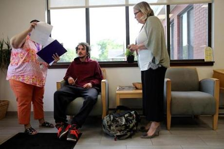 Adam Carreira, 22, of New Bedford (center) talked with intake worker Deborah Booker (left) and OTC Clinician Kathy Belanger at the Open Access Clinic at SSTAR, a treatment facility in Fall River.