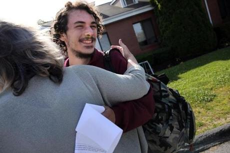 Adam Carreira, 22, of New Bedford (center) got a hug from OTC Clinician Kathy Belanger outside the Open Access Clinic at SSTAR, a treatment facility in Fall River.
