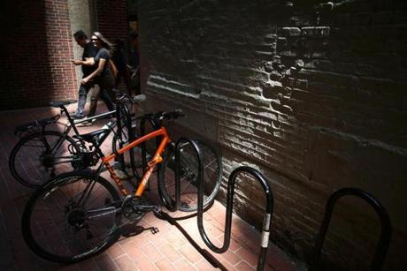 Bicycles were parked recently in the alley, the name of which may be tied to the cith's newspaper past.