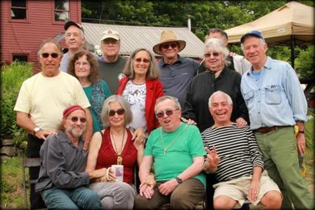 Commune members at a 50th reunion in June at Total Loss Farm. Standing, second from left,  Harry Saxman. Sitting, from left: Peter Simon, Verandah Porche, and Ray Mungo.