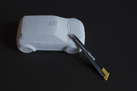 July 18, 2018 - CBT Architects Items from Mr. Wojciechowski's office - a 3D printing of his Mini Cooper as he was experimenting with the scaling capabilities and an exactor knife that he used prior to the advent of technology in his job Alfred Wojciechowski, 61 years old is a Principal at CBT Architects with over 32 years at the firm. 22workspace, business, Logan Photo by Katherine Taylor for The Boston Globe