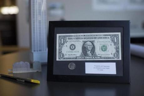 "July 18, 2018 - CBT Architects Items from Mr. Wojciechowski's office - a framed $1 bill and a dime signifying ""110"" Canal Street (the address of the firm) an exactor knife and modelings of buildings Alfred Wojciechowski, 61 years old is a Principal at CBT Architects with over 32 years at the firm. 22workspace, business, Logan Photo by Katherine Taylor for The Boston Globe"
