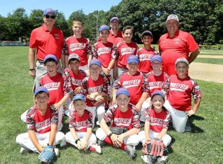 The Wakefield Warriors little league team posed for a photo before their first game of the season.