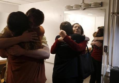 Boston, MA -- 3/23/2018 - Moments before their final performance at the drama competition, Deb (R) embraced her fellow cast members. The actors tried to push the finality of this moment aside, but the truth remained: they would never be together like this again. (Jessica Rinaldi/Globe Staff) Topic: Reporter: Jenna Russell