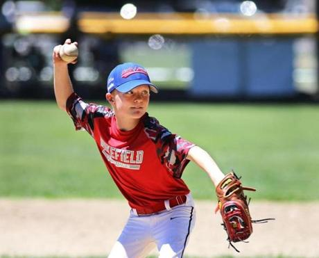 Ethan Faulkner of the Wakefield Warriors threw the last pitch of the game against North Reading.