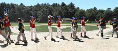 Players from North Reading and Wakefield greeted each other after a July 8 game.