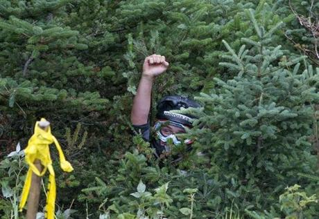 A fist among the foliage signaled that Zach Gareis was OK.