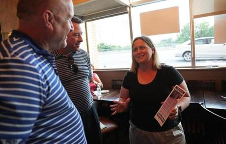 Charlestown, MA - 8/28/2018 - Katie Forde, candidate for Suffolk County Register of Deeds, campaigning at an event at Blackmore Bar and Kitchen restaurant in Charlestown talks with Chris Remmes, Ward Committee member and State Rep. Dan Ryan. (Barry Chin/Globe Staff), Section: Metro, Reporter: JD Capelouto, Topic: 29deeds, LOID: 8.4.2983590643.