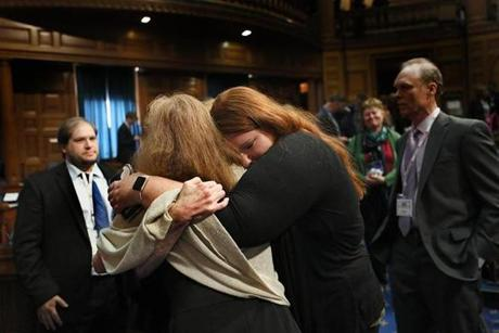 "Boston, MA., 09/11/18, Seventeen years after the events of 9/11, remembrances and ceremonies are held at the Massachusetts State House. The family of Madeline ""Amy"" Sweeney, the flight attendant on American Flight 11, embraces after the award ceremony honoring her. It is called The Madeline ""Amy"" Sweeney Award for Civilian Bravery. Her daughter, Anna Sweeney is on the right. Suzanne Kreiter/Globe staff"