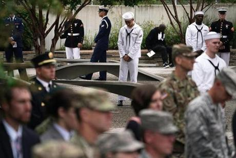 ARLINGTON, VA - SEPTEMBER 11: Members of U.S. military forces stand next to benches during a cereomy at the National 9/11 Pentagon Memorial to mark the 17th anniversary of the 9/11 terror attacks September 11, 2018 in Arlington, Virginia. The nation observed 9/11 terror attacks that killed nearly 3000 people on American soil in 2001. (Photo by Alex Wong/Getty Images)