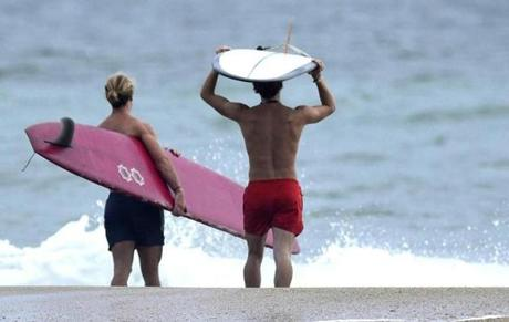 Adam Gartrell (left) and Colin Kern walked out toward the surf in Wrightsville Beach, N.C.