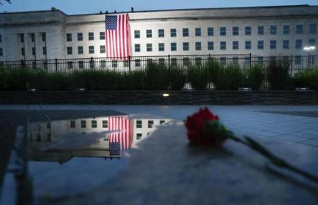 A flag is unfurled at sunrise at the Pentagon on the 17th anniversary of the September 11th attacks.