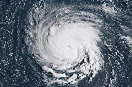 "TOPSHOT - This NOAA/RAMMB satellite image taken at 11:45:31 UTC on September 10, 2018, shows Hurricane Florence off the US east coast in the Atantic Ocean. - Hurricane Florence is expected to become a dangerous ""major hurricane"" by late Monday as it heads toward the US East Coast, the National Hurricane Center said, as states of emergency were declared in preparation for the storm. The center of Florence was located about 685 miles (1,100 kilometers) southeast of Bermuda, the NHC in its 0300 GMT Monday advisory.Florence had maximum sustained winds of 90 miles per hour, making it a Category 1 storm on the five-level Saffir-Simpson hurricane scale. (Photo by HO / NOAA/RAMMB / AFP) / RESTRICTED TO EDITORIAL USE - MANDATORY CREDIT ""AFP PHOTO / NOAA/RAMMB"" - NO MARKETING NO ADVERTISING CAMPAIGNS - DISTRIBUTED AS A SERVICE TO CLIENTSHO/AFP/Getty Images"