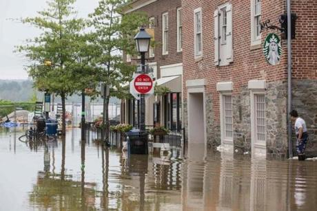 Water flooded outside buildings in Old Town Alexandria, Virginia, on Tuesday.