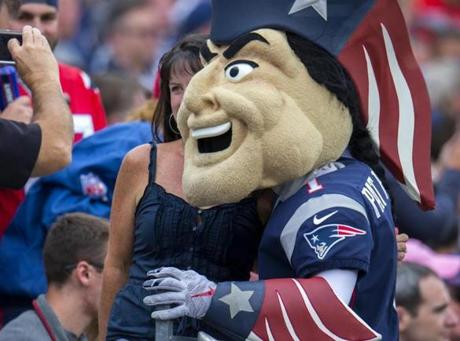 Pat Patriot mingles with fans.