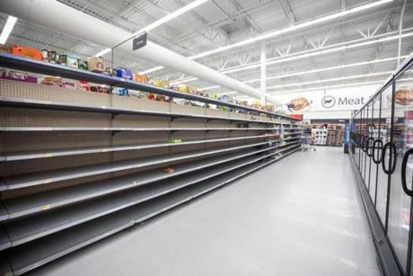Mandatory Credit: Photo by JIM LO SCALZO/EPA-EFE/REX/Shutterstock (9880068b) The bread aisle at Walmart is empty two days before Hurricane Florence is expected to strike Wilmington, North Carolina, USA, 12 September 2018. Hurricane Florence is a category 4 storm on the Saffir-Simpson Hurricane Wind Scale, with winds toping 165 miles per hour. No category 4 hurricane has ever made landfall in North Carolina. Hurricane Florence to strike East Coast of United States, Wrighstville Beach, USA - 12 Sep 2018