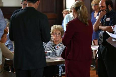 Methuen, MA - 9/13/18 - The counter and caller at this table are surrounded by observers. The Methuen Board of Voter Registrars, with volunteer counters, callers and runners, conducts a recount for the Third Congressional District Democratic Primary race. They are using the Great Hall in City Hall. Methuen is one of 37 cities and towns doing a recount. Photo by Pat Greenhouse/Globe Staff Topic: 14recount Reporter: Joshua Miller