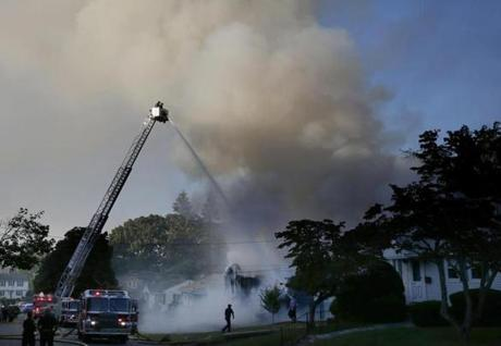 Lawrence, MA--9/13/2018-- Crews work to knock down a fire on Jefferson Street in Lawrence. (Jessica Rinaldi/Globe Staff) Topic: Reporter: