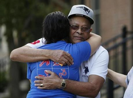 Lawrence, MA--9/14/2018-- The father of Leonel Rondon is embraced outside of the family's home in Lawrence. London was killed yesterday when a chimney from a house explosion landed on his car. (Jessica Rinaldi/Globe Staff) Topic: 15lawrencepic Reporter: