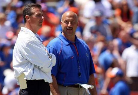 GAINESVILLE, FL - APRIL 10: Head coach Urban Meyer of the Florida Gators talks with offensive coordinator Steve Addazio, R, during the Orange & Blue game at Ben Hill Griffin Stadium on April 10, 2010 in Gainesville, Florida. (Photo by Doug Benc/Getty Images)