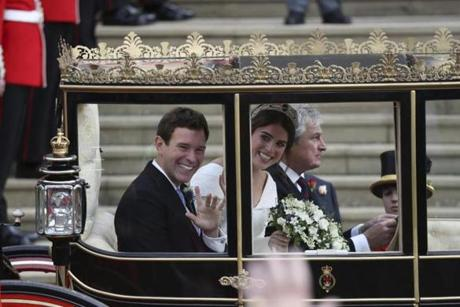 Princess Eugenie of York and Jack Brooksbank leave in a carriage after their wedding ceremony at St George's Chapel, Windsor Castle, near London, England, Friday Oct. 12, 2018. (c)