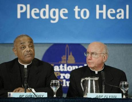 Bishop Wilton Gregory of Bellville, Ill.,, president of the U.S. Conference of Catholic Bishops, left, and Archbishop Harry Flynn, of St. Paul and Minneapolis, take part in a news conference at the National Press in Washington Friday, Feb. 27, 2004, to discuss a National Review Board report on clerical sexual abuse. (AP Photo/Ron Edmonds)