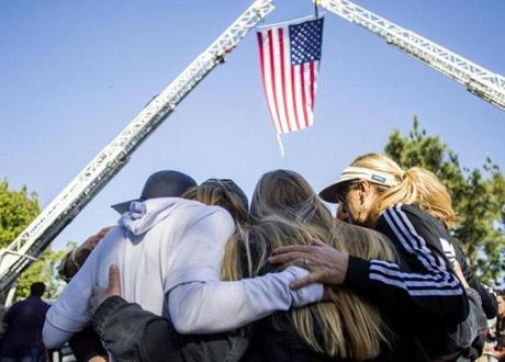 Friends hug outside Los Robles Medical Center in Thousands Oaks, California, paying tribute to Ventura Country Sheriff's Sgt Ron Helus, killed in the shooting at the Borderline Bar in Thousands Oaks on November 08, 2018. - The gunman who killed 12 people in a crowded California country music bar has been identified as 28-year-old Ian David Long, a former Marine, the local sheriff said Thursday. The suspect, who was armed with a .45-caliber handgun, was found deceased at the Borderline Bar and Grill, the scene of the shooting in the city of Thousand Oaks northwest of downtown Los Angeles. (Photo by Apu Gomes / AFP)APU GOMES/AFP/Getty Images