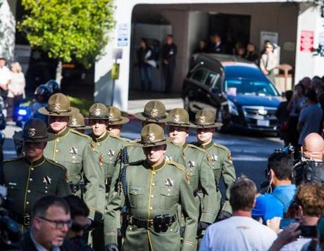 Ventura Sheriff Officers open the way for a motorcade, carrying Ventura Country sheriff Sgt. Ron Helus who was killed in a shooting at Borderline Bar the night before, outside the Los Robles Medical Center in Thousands Oaks, California on November 8, 2018. - The gunman who killed 12 people in a crowded California country music bar has been identified as 28-year-old Ian David Long, a former Marine, the local sheriff said Thursday. The suspect, who was armed with a .45-caliber handgun, was found deceased at the Borderline Bar and Grill, the scene of the shooting in the city of Thousand Oaks northwest of downtown Los Angeles. (Photo by Apu Gomes / AFP)APU GOMES/AFP/Getty Images